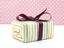 Gift box pink present with ribbon on pink background Stock Photography