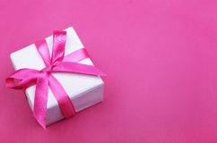 Gift box with pink ribbon Stock Image