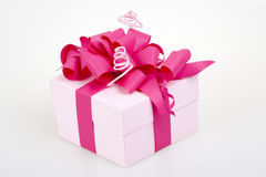 Gift box with pink ribbon Stock Photography