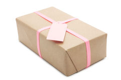 Gift box with pink ribbon and label. royalty free stock photo