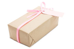 Gift box with pink ribbon and label. stock photos