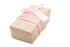 Gift box with pink ribbon and label. stock image