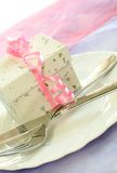 Gift box with pink ribbon on plate Stock Images