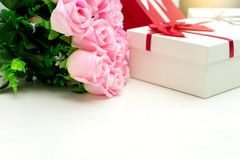 Gift box with pink rose flower for lover valentine. For background Stock Image