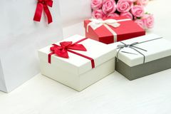 Gift box with pink rose flower for lover valentine. For background Royalty Free Stock Photo