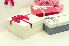 Gift box with pink rose flower for lover valentine. For background Stock Photos