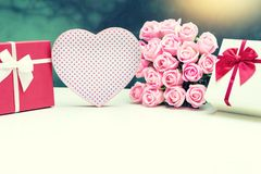 Gift box with pink rose flower for lover valentine. For background Stock Photography