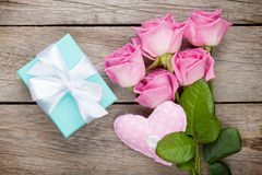 Gift box, pink roses bouquet and heart toy Royalty Free Stock Photo