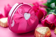 Gift box, Pink roses and candy, closeup. Valentines Day Royalty Free Stock Images