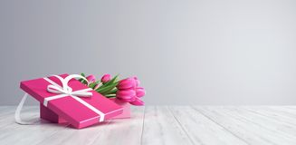 Gift box with pink tulips on white wood boards royalty free stock photos