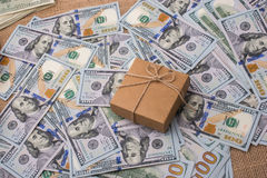 Gift box placed on spread US dollar banknotes. Gift box placed  is placed on spread US dollar banknotes Stock Photography