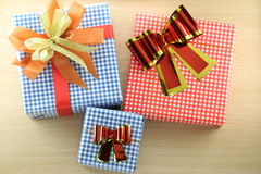 Gift box is placed on wooden floor. Stock Photos