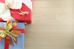 Gift box is placed on wooden floor. Stock Photo
