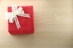 Gift box is placed on wooden floor. Stock Image