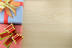 Gift box is placed on wooden floor. Stock Images