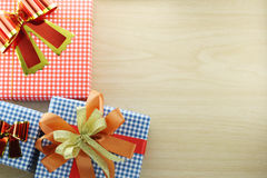 Gift box is placed on wooden floor. Royalty Free Stock Images