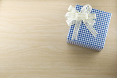Gift box is placed on wooden floor. Royalty Free Stock Photo
