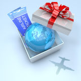 Gift box with planet earth inside and airplane tickets Stock Photo