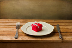 Gift box on plate Royalty Free Stock Photography
