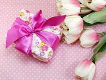Gift box present and artificial tulip flowers decoration background Stock Image