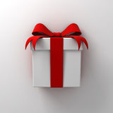 Gift box present with red ribbon bow on white wall background with shadow. 3D rendering Stock Photo