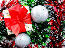Gift box present with red ribbon christmas background Stock Images