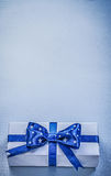 Gift box with present tape on blue background holidays concept Stock Images