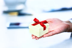 Gift box / present or valentine gift hand close up. Stock Image