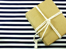 Gift box present wrapped in recycled paper and white rope Stock Photo