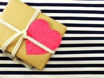Gift box present wrapped in recycled paper and white rope Royalty Free Stock Photo