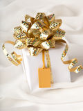 Gift box with a price tag Stock Photography