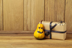 Gift box with pumpkin and spider decoration. Halloween concept Royalty Free Stock Photography