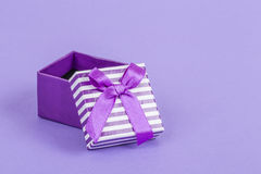 Gift box on purple Royalty Free Stock Photography