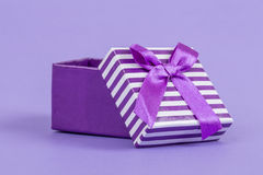 Gift box on purple Royalty Free Stock Images