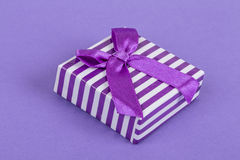 Gift box on purple Stock Photography