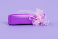 Gift box on purple Royalty Free Stock Image