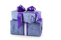 Gift box with purple bow isolated on white background Royalty Free Stock Images