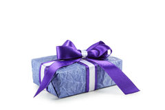 Gift box with purple bow isolated on white background Stock Images