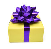 Gift box and purple bow Stock Images
