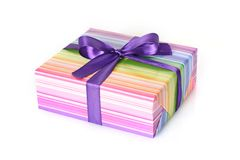 Gift box with purple ribbon. On white stock photos