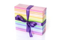 Gift box with purple ribbon. On white stock image