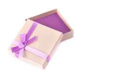 Gift box with purple ribbon bow, isolated on white Royalty Free Stock Photos