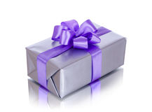 Gift box with purple ribbon on white background Royalty Free Stock Image