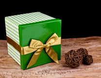 Gift box and rattan balls Stock Photography