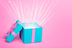 Gift box with a rays of the sun or the light shine Royalty Free Stock Photo