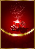Gift box on red background with Christmas ball Stock Photo