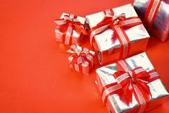 Gift box on red background for Christmas royalty free stock photo