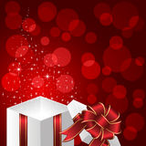 Gift box on red background with stars Stock Photography