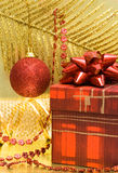 Gift box and red ball Royalty Free Stock Photos