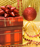 Gift box and red ball Royalty Free Stock Photo